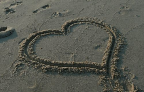 picture of heart drawn in the sand